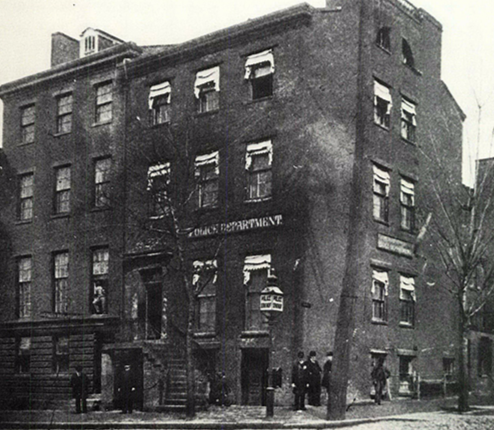 A photograph of the DC police headquarters in the latter half of the 19th century.