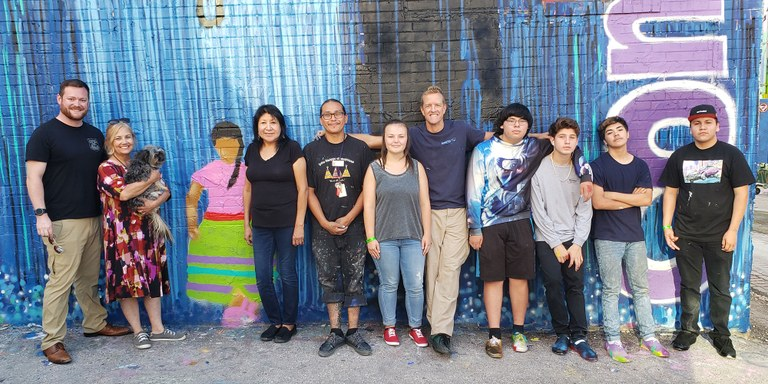 A photo of Rapid City community members involved in the domestic violence awareness mural project.