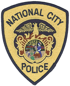The National City, California, Police Department's patch depicts an eagle, representing bravery, strength, and integrity, atop a shield, symbolizing vigilance and protection. The great seal of California is in the center of the patch. National City's agricultural history is depicted in the two orchids, the city's official flower, and the rays of sun surrounding the state's seal.