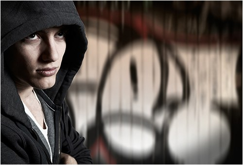 Gang Member and Graffiti (Stock Image)