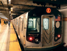 A New York City subway train at a station.