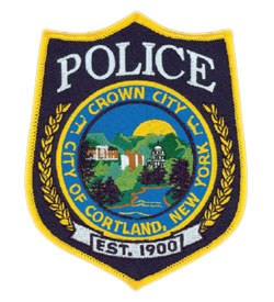 Cortland, New York is called the Crown City because of its location in the center of seven valleys in the middle of the state. The patch of its police department depicts this, as well as the city's role in importing and exporting items by river. Also featured are three prominent buildings in Cortland.