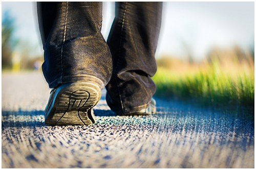 Stock image of a person walking on a path.