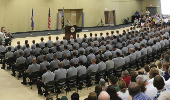 Law enforcement professionals congregate to hear a notable speech.