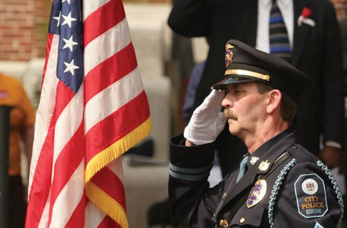 Officer Saluting Flag