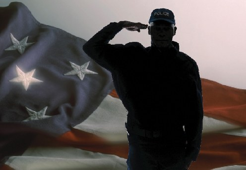 Officer saluting in front of an American flag.