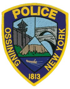 "The village of Ossining (meaning ""stone on stone""), New York, was incorporated in 1813 as Sing Sing. Though the village changed its name in 1901 to avoid confusion with the famous local prison, its police department patch depicts on the upper left the facility's historic walls. Also shown are the dual arches of a roadway and former aqueduct and a canoe moving down the Hudson River."