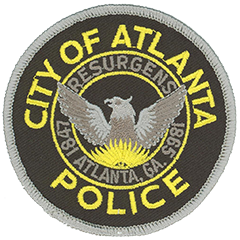 "The Seal of the City of Atlanta, Georgia, was adopted in 1887, just 23 years after the city was captured and burned by General William T. Sherman's forces during the Civil War. It stands as an enduring symbol of courage, vision, and selflessness and prominently is featured on the service patch worn by Atlanta Police Department officers. A phoenix is pictured rising from the flames of its destruction; the Latin term ""resurgens,"" shown above the mythical bird, appropriately means ""rising again."" The dates on either side of the seal represent the city's incorporation in 1847 and its reconstruction in 1865."