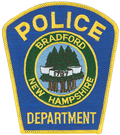 The town seal of Bradford, New Hampshire, is prominently featured on the service patch of the Bradford Police Department, which serves over 1,600 residents. First settled in 1771 the town was incorporated by the New Hampshire General Court in 1787. This incorporation date is depicted in a banner at the center of the seal. Several of the state's tallest white pines, which grow in Bradford, are portrayed in the background. These towering monuments of nature exemplify the open forest that once covered most of southern New Hampshire.