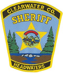 "Clearwater County, Minnesota, is home to Lake Itasca, the traditionally accepted source of the Mississippi River. The name ""Itasca"" is a combination of the Latin words for truth (veritas) and head (caput) and was chosen to designate the Mississippi's ""true head,"" or headwaters. The lake and its flow into the river are depicted amongst rocks and majestic pines in the foreground of the service patch for the Clearwater County Sheriff's Office. The center of the patch features the Minnesota state seal enclosed in a gold star."