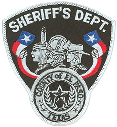 The patch of the El Paso County, Texas, Sheriff's Department depicts three of the many cultures that settled the southwest—the American Indian, Spanish conquistador, and American cowboy. Bordering these representations are banners of the state of Texas' Lone Star Flag and the seal of El Paso County. As part of the old wild west, El Paso played host to the likes of Pancho Villa, William Bonney (a.k.a. Billy the Kid), and John Wesley Hardin. Today the city and its neighbor across the border, Ciudad Juarez, Mexico, have developed into a modern and progressive region, forming the largest bilingual, binational workforce in the Western Hemisphere.