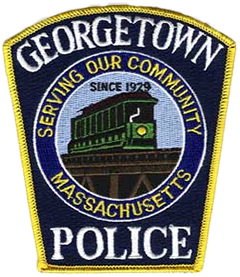 "Georgetown, Massachusetts, a distant suburb of Boston's North Shore, was incorporated in 1838, though first settled almost 200 years earlier as a part of the town of Rowley. The Georgetown Police Department was established in 1929, and its motto, ""Serving Our Community,"" can be seen on its officers' service patch. The trolley that served Georgetown from 1886 to 1940 is prominently depicted as traveling over a tall trestle that no longer exists. The trestle's former location is marked today by a housing complex."
