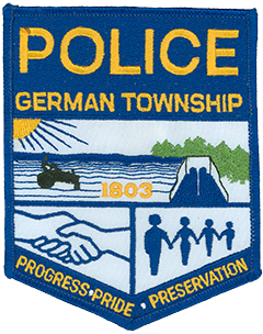 German Township in Montgomery County, Ohio, is one of five townships statewide with the same name. The city of Germantown is its respective municipality and home to the German Township Police Department. The department's service patch depicts the township logo, representing a friendly rural community at the bottom and showing spacious farmland and a local dam at the top. The area first was organized in 1803 by German-speaking settlers from Berks County, Pennsylvania—this founding year is shown at the center of the patch.