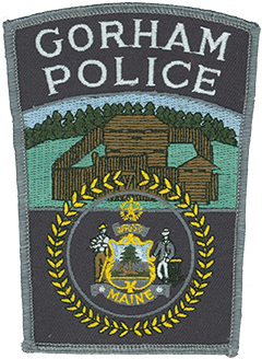 "The Gorham, Maine, Police Department patch prominently illustrates the historic fort in which early settlers found safe refuge during the French and Indian War. The Great Seal of Maine is shown below, depicting a farmer leaning on a scythe on the left and a sailor leaning on an anchor on the right. They represent Maine's strong agricultural and seafaring heritage. The moose at the center of the seal represents Maine's wildlife, while the adjacent pine tree is the symbol for Maine, nicknamed ""The Pine Tree State."""