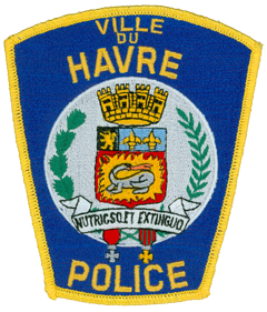 "The city of Havre Montana, was named after the French port city of Le Havre after residents elected to change its name from Bullhook Bottoms. The patch of the Havre Police Department depicts the coat of arms of Le Havre. It features a rampart at the top, a lion rampant and two fleurs-de-lis in the middle, branches of oak and olive leaves to the sides, and the Cross of the Legion of Honor and the War Cross at the bottom. Most noteworthy is the salamander in the coat's center, which was the personal emblem of King Francis I, the founder of Le Havre. The king's personal motto, translated, ""I stoke and extinguish,"" references the salamander's alleged ability to stay alive in flames."
