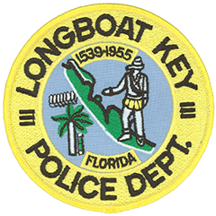 The town of Longboat Key, Florida, is located on a barrier island along the state's west coast. Incorporated in 1955 it is vibrantly shown at the center of the local police department patch. Atop the island stands a depiction of Hernando de Soto, the Spanish conquistador who discovered the island in 1539. The palm tree and small growth beside it signify the lush island found by the explorers. The seven white figures directly above represent sailors manning a longboat—the town's namesake—from their sailing ship. The patch's yellow outer circle embodies the bright Florida sun, while the blue inner circle signifies the Gulf of Mexico.