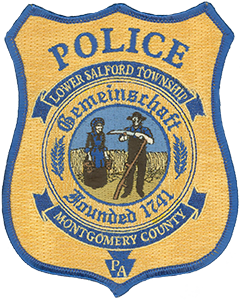 "Lower Salford Township, Pennsylvania, was founded in 1741 in modern day Montgomery County, about 30 miles north of Philadelphia. The township seal is prominently displayed on the Weissbier-colored patch of the local police department and pays homage to the area's rich history. The center depicts a Pennsylvania Dutch couple in front of a wheat field—many of Lower Salford's early settlers were of Germanic descent, and most came from an agricultural background. Above the depiction is the word ""gemeinschaft,"" which is German for ""a sense of community."""