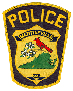 The city of Martinsville, Virginia, was named after Revolutionary War General and pioneer Joseph Martin, who first settled in the area in 1773. The patch of the city's police department prominently depicts a shield encompassing the state of Virginia with a star near the bottom indicating the location of Martinsville. Also featured are the state bird, the cardinal, and the state flower, the dogwood.