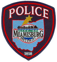 "The patch of the Miamisburg, Ohio, Police Department prominently displays the city seal surrounded by an outline of the state. The seal depicts the historic skyline of downtown Miamisburg above the Great Miami River, which runs through the area. The gold star emanating from the outline of Ohio illustrates the city's location and represents its motto: ""Ohio's star city."" The date of Miamisburg's incorporation, 1818, is at the bottom of the patch."