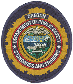The patch of the Oregon Department of Public Safety Standards and Training incorporates several attributes that denote the agency's statewide mission. The two stars amidst the agency's name represent its two primary functions: establishing and enforcing minimum standards and providing training for public safety officers and staff within the state. The Oregon state seal in the center signifies the agency's cabinet-level role, and the badge format reflects the history and tradition of the agency and those it serves. Each of the colors depicted are significant—gold represents integrity, blue conveys honor, red symbolizes courage, and white embodies peace and sincerity.