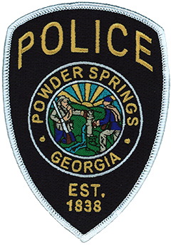 The city seal of Powder Springs, Georgia, is prominently featured on the service patch of the local police department. The seal depicts a Confederate and Union soldier sharing water at a pump. The water pump is symbolic of the mineral-enriched seven springs in the city limits that turn the surrounding sand black, like gunpowder. This distinct feature led to the city's renaming in 1859—it was initially incorporated 21 years earlier as Springville. From the 1850s to the Civil War, the area was widely known as a health resort—some doctors prescribed a trip to the springs to treat kidney and bladder disease.