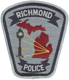 "Richmond, Michigan, first was settled in 1835 by members of an English community in New York State who ventured into the Michigan wilderness determined to carve out a prosperous city. The arrival of the Grand Trunk Railway in 1859 secured the community's success, and in 1878 it merged with two neighboring settlements to form Richmond. In 1924 a successful Detroit merchant born in Richmond paid tribute to his hometown by erecting its now-historic town clock, prominently depicted on the service patch of the Richmond Police Department, along with four emanating rays showing the city's location on an outline of the state. The clock features Richmond's motto—""With time for you""—which has become a logo for the city."