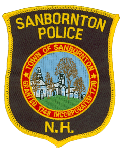 The town of Sanbornton, New Hampshire was granted by the colonial governor to his friend John Sanborn in 1748. He was accompanied by 59 settlers from the New Hampshire towns of Hampton, Exeter, and Stratham. Following its permanent settlement, Sanbornton was incorporated in 1770. The patch of the Sanbornton Police Department features the town seal, which depicts the town library, congregation church, and town hall, all located in the historic district.