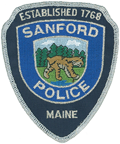 The city of Sanford, Maine, which includes the village of Springvale, is situated on the Mousam River in the state's southernmost county. First settled in 1739 and established as a town in 1768, Sanford was rechartered as a city on January 1, 2013. It is named after Peleg Sanford, the colonial governor of Rhode Island from 1680 to 1683. The city is known for its lakes and wooded areas, which at one time were heavily populated by bobcats. These natural features are depicted on the service patch of the Sanford Police Department. The bobcat is the symbol of the department; though difficult to see, it is represented stepping on a mouse.