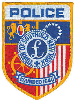 The town of Southold, New York, dates back to 1640 and is the first English settlement on Long Island. The Southold Police Department service patch features the town seal in its center, depicting the symbol for the British pound sterling, a reference to William Alexander, First Earl of Stirling, who was granted ownership of Long Island by King Charles I. Behind the seal on the upper left is the Royal Coat of Arms, representing the town's English heritage. The lower left depicts a ship's wheel, symbolizing the town's dependence on and relationship with the sea. The right side of the patch contains the 13 stars and stripes of the first American flag. The banner in the lower portion of the patch proudly proclaims Southold's founding year.