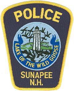 "Sunapee, New Hampshire, is a resort community of 3,365 full-time residents. Over the summer, visitors to nearby Lake Sunapee double the town's population to nearly 7,000. The word Sunapee is derived from the Algonquian Indian words suna—meaning ""goose""—and apee—meaning ""lake."" The phrase ""Lake of the Wild Goose"" is depicted on the patch of the Sunapee Police Department at the bottom of the town seal. The Loon Island Lighthouse, one of three still-functioning lighthouses from the 1890s situated on the lake, is shown center. True to the area's name, a flock of wild geese is depicted in flight above the lake."
