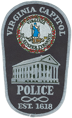 "The Virginia Division of Capitol Police is the first organized policing agency in America. Its roots originate in 1618 at the first permanent English settlement in Jamestown. Based today in Richmond, the agency has evolved with the state's seat of government over the past 396 years. The official seal of Virginia is depicted atop the agency's service patch. The seal features a female figure representing virtue standing over a fallen male figure representing tyranny. The Latin inscription ""Sic Semper Tyrannis"" translates to ""Thus Always to Tyrants."" The Virginia state capitol is depicted beneath the seal as it was originally designed by Thomas Jefferson in 1785. Jefferson modeled the building after the Maison Carrée, an ancient Roman temple in Nîmes, France."