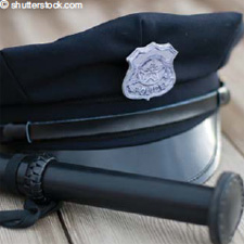 Depiction of an officer's hat and baton.