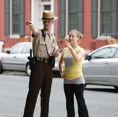 A police officer assists a campus student with directions.