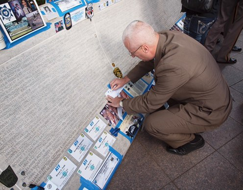 FBI Instructor Philip Wright creates impressions of fallen troopers at the National Law Enforcement Officers Memorial.