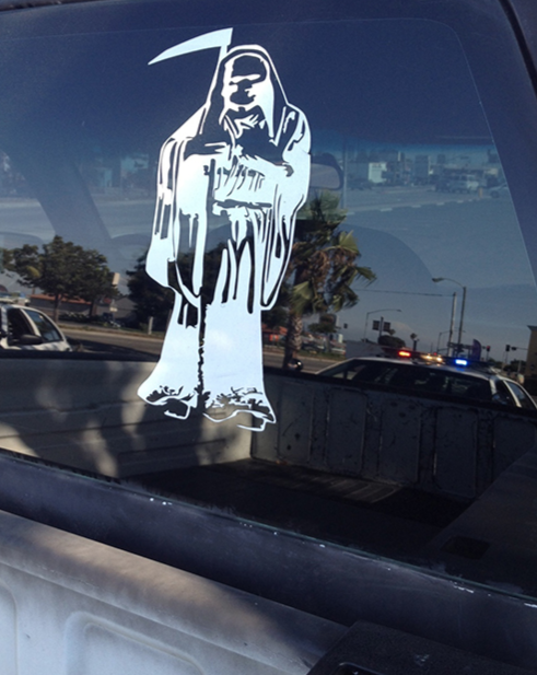 A Santa Muerte decal is shown on the window of a car. Photo provided by U.S. law enforcement.