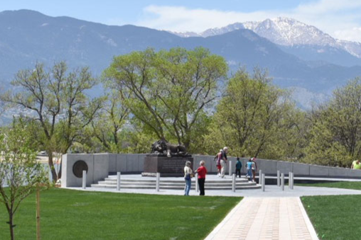 Image of the Pikes Peak Region Officers' Memorial from a distance which includes the walkway leading toward the memorial.