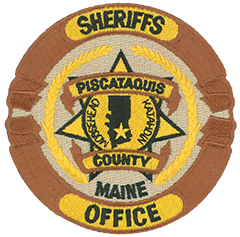 The Piscataquis County, Maine, Sheriff's Office serves the only designated wilderness area east of the Mississippi. Its patch recognizes two notable landmarks. Moosehead Lake is known for camping, fishing, and snowmobiling. Mount Katahdin challenges hikers from all over the world and marks the northern end of the Appalachian Trail.