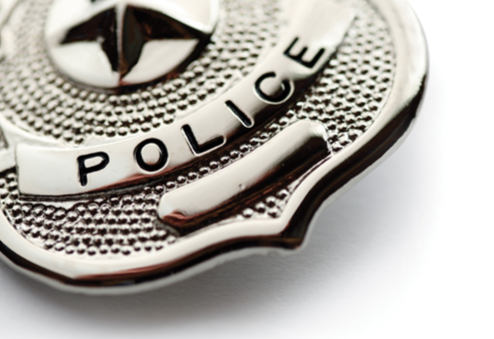 Stock image of a close-up of a police shield.