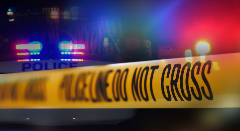 A stock image of police crime scene tape and police lights.