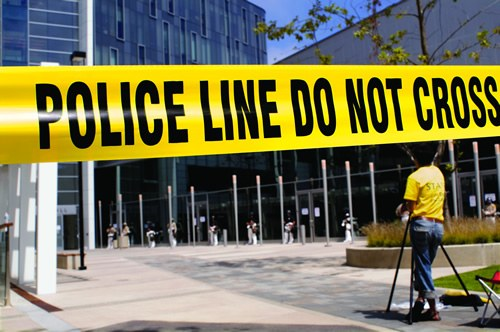 Police Line Tape in Front of Buildings