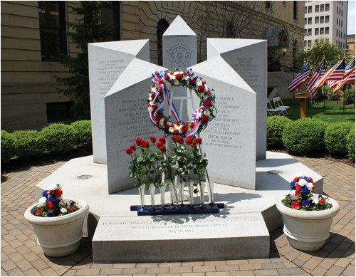 In Canton, Ohio on May 21, 1994, the Fraternal Order of Police (FOP) McKinley Lodge No. 2 Police Memorial was dedicated. This monument is located on the grounds of the Stark County Courthouse in downtown Canton. Modeled after the emblem of the FOP star, this tribute to fallen officers is constructed of Berrie Gray Vermont granite.
