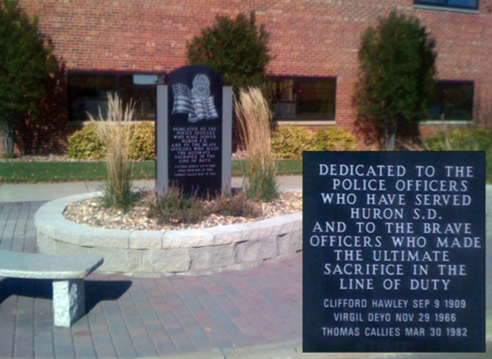The Police Memorial in Huron, South Dakota, was dedicated on May 21, 2011. This monument, located near the municipal building, memorializes Huron police officers killed in the line of duty.