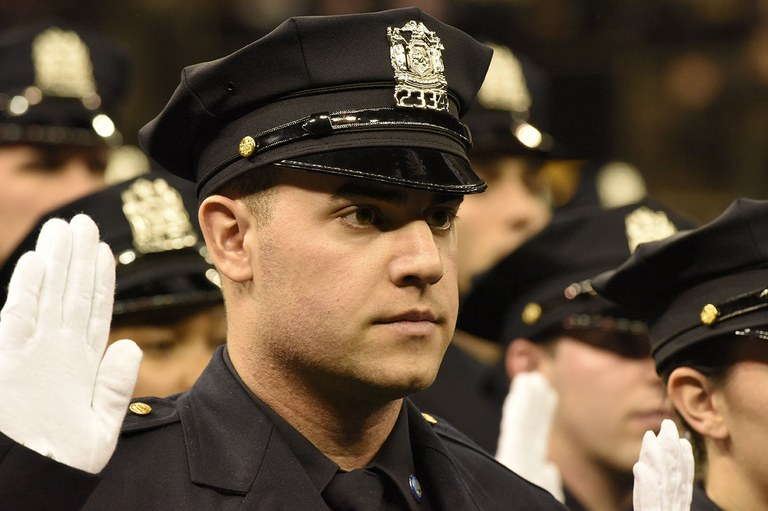 A stock image of a police officer taking an oath.