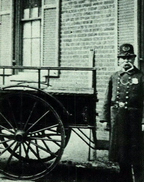 Photograph of a DC police officer in the late 19th century.