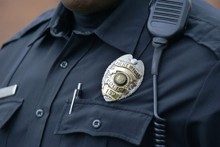 A stock image of a police officer in uniform.