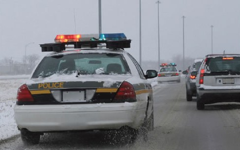 Police Vehicles in Pursuit During Winter Weather