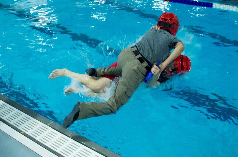 Two trainees engaged in a training exercise in the new FBI Academy pool.