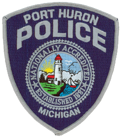 "The Port Huron (Michigan) Police Department was established in 1881 and is nationally accredited by the Commission on Accreditation for Law Enforcement Agencies (CALEA). Its patch proudly depicts these achievements alongside the historic Fort Gratiot Lighthouse, the first of its kind in Michigan. Built in 1829, the lighthouse marks the channel into the St. Clair River from Lake Huron and is still active. Port Huron is considered the ""Maritime Capital of the Great Lakes."""