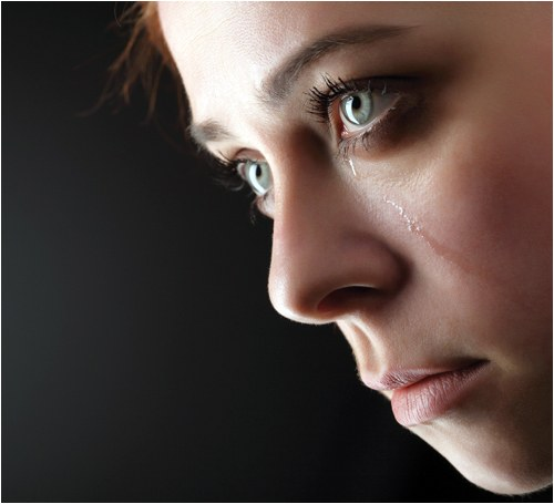 Stock image of a young woman crying. © shutterstock.com.