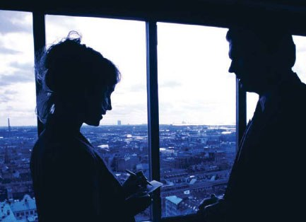 Profile Silhouettes of a Man and Woman in Front of a Window (Stock Image)